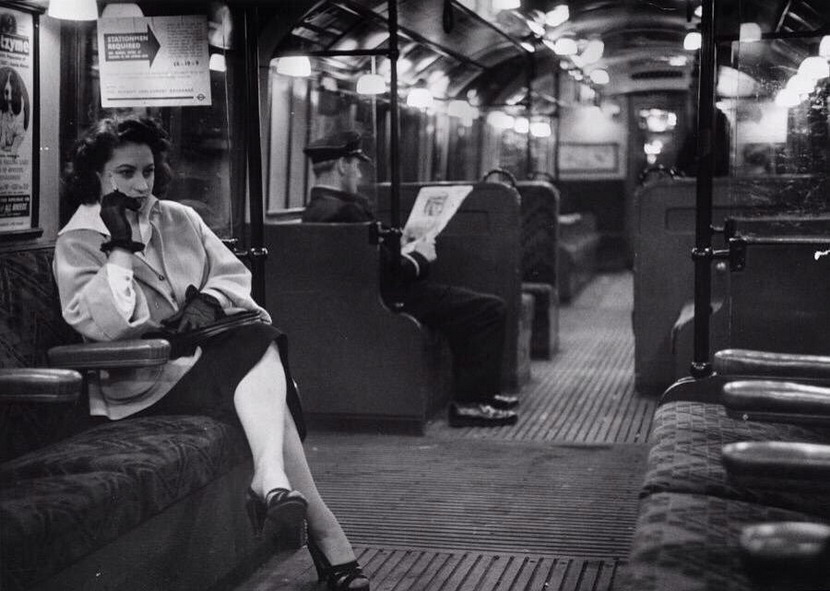 Woman in a subway car, London Underground, circa 1950