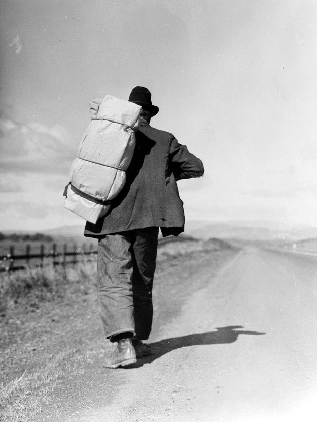 Unemployed man walking to California to search for work, Depression era, 1930s