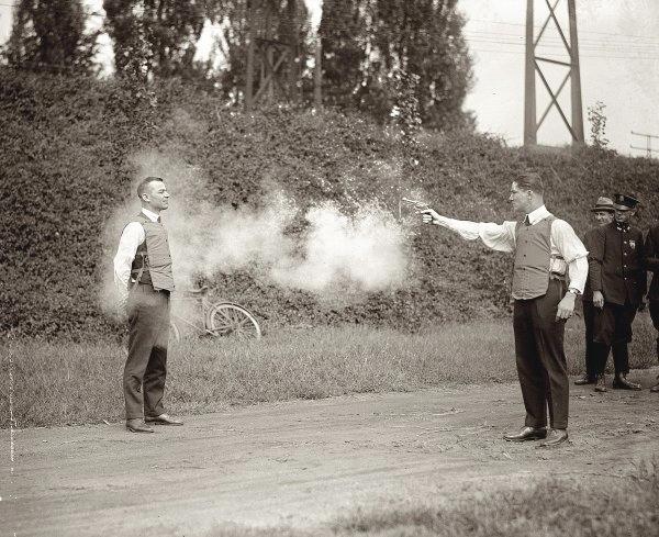 Testing a bullet proof vest,1910s