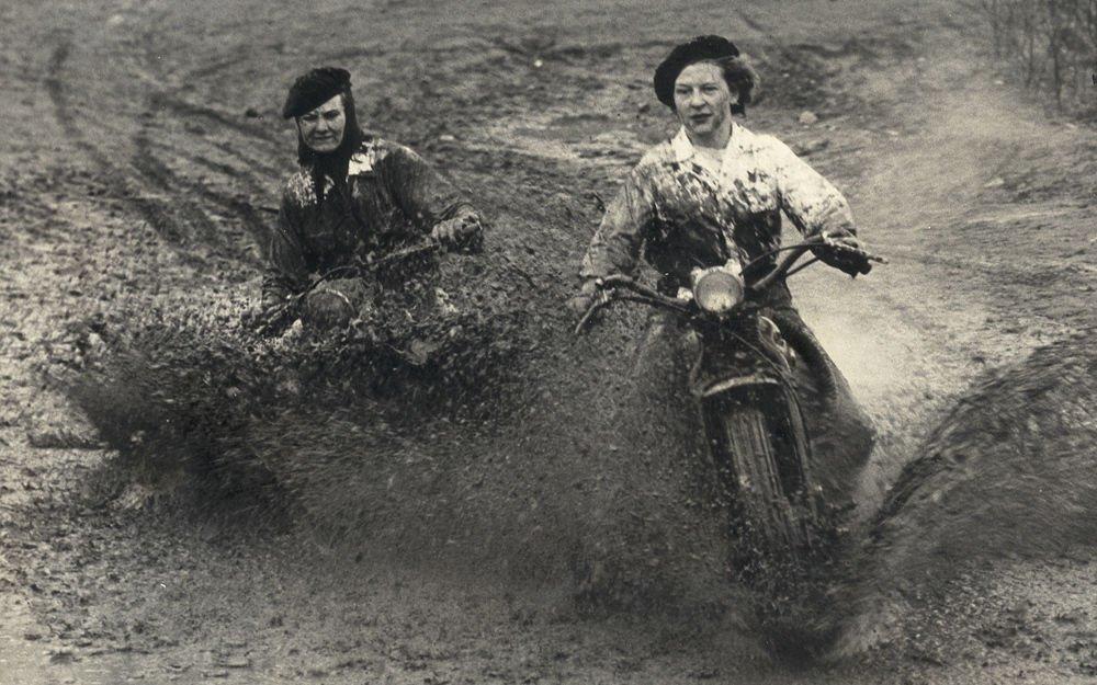 Ladies doing a mud run,1940s