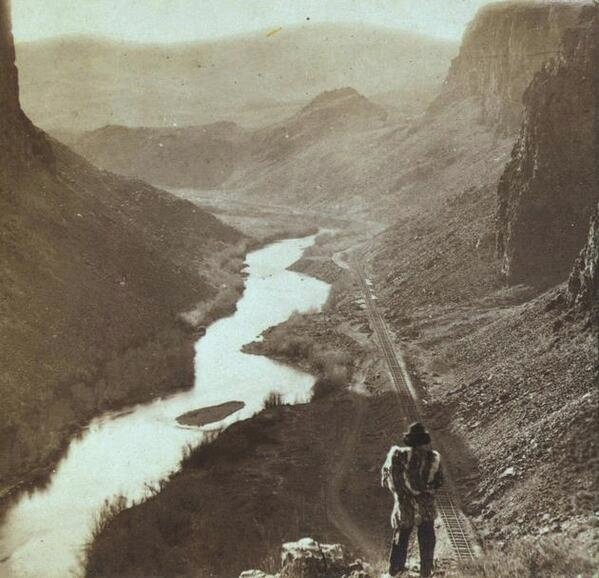 Native American looking down at the first transcontinental railroad line,1800s
