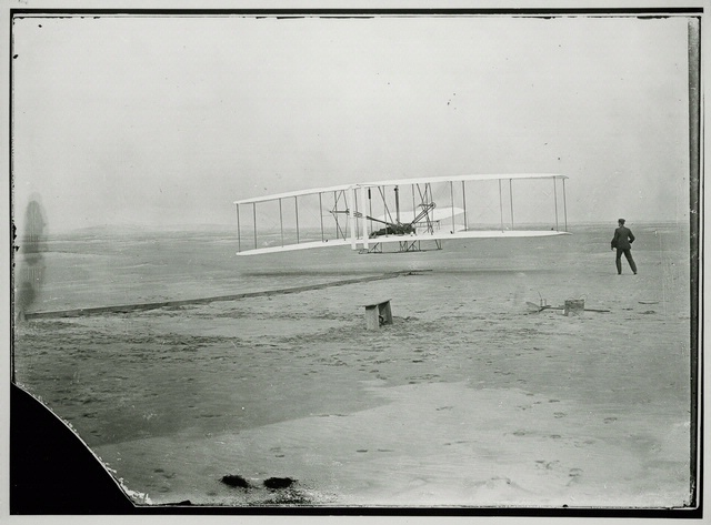 "The Wright Brothers experimenting with their new invention ""the aeroplane"" on the beaches of North Carolina, 1903"
