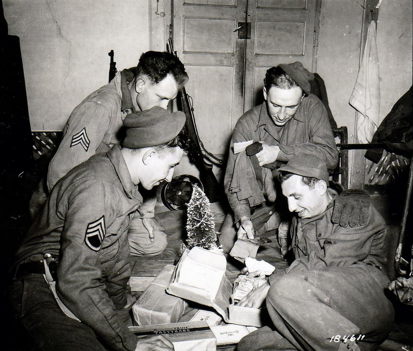Soldiers opening Christmas care packages,WWII