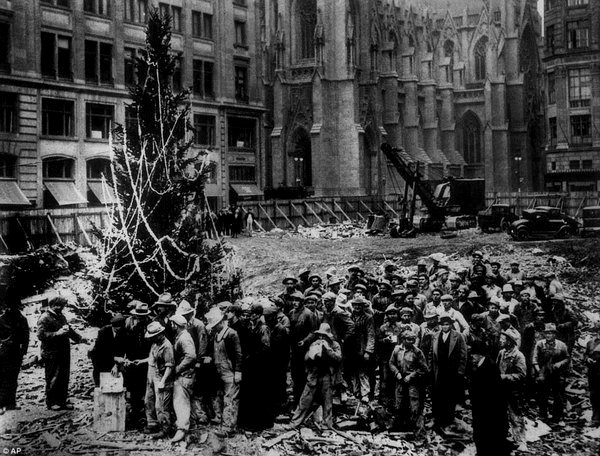 The first Christmas tree to be put up at Rockefeller Center, when it was still under construction,1930s