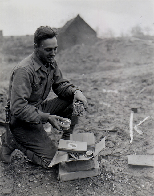 Soldier receiving Christmas care package at the front lines,WWI