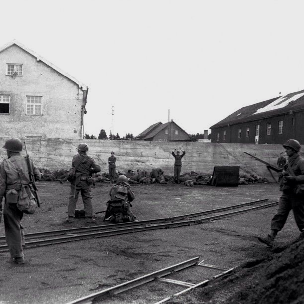 American soldiers shooting Nazi (SS) guards after the liberation of the Dachau concentrationcamp