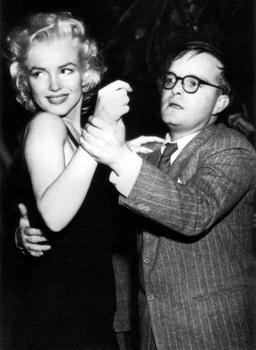 Marilyn Monroe and Truman Capote dancing awkwardly