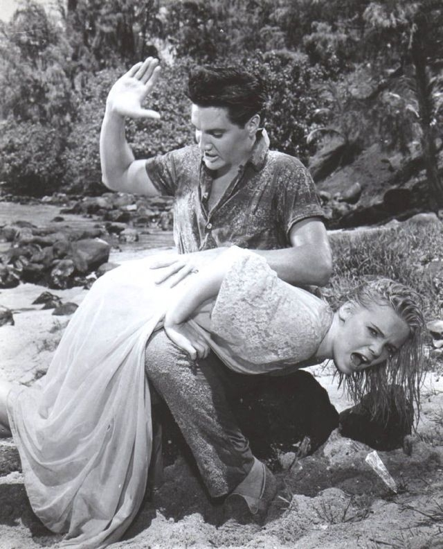 Elvis giving Jenny Maxwell a good spanking (this shot apparently took four takes, so she got spanked fourtimes)