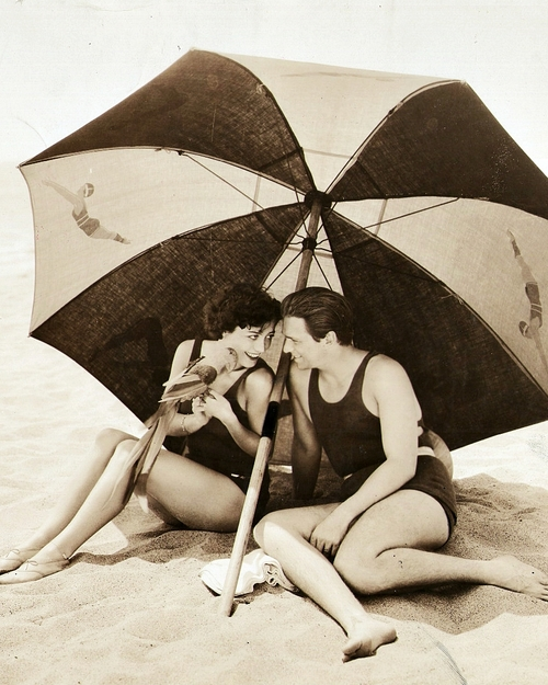 Joan Crawford and Douglas Fairbanks Jr. at the beach with a parrot,1929