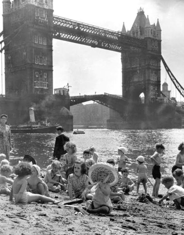 Children on the banks of the Thames, London, early 1950s