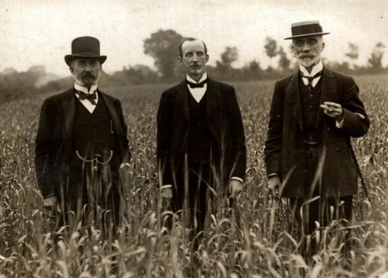 Three men in a field, circa1905