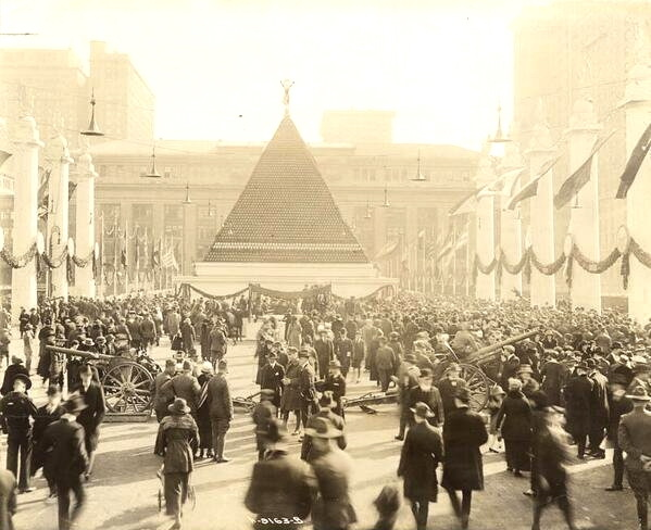 Pyramid shaped display of captured German helmets in Grand Central Station, NYC, WWI
