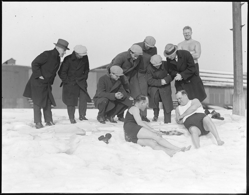 "South Boston ""polar bear club"" members playing checkers in the snow on a beach in winter, 1920s"