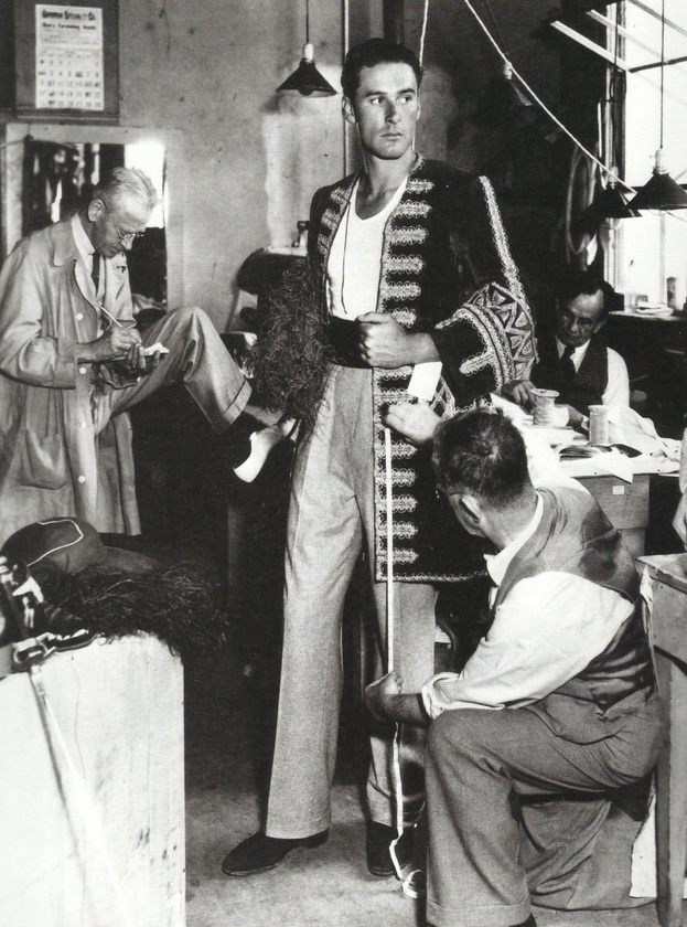 """Errol Flynn during a costume fitting for """"Captain Blood"""",1930s"""