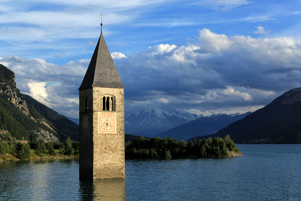 Clock tower in a lake in Northern Italy (A village that Mussolini intentionally drowned with a dam because they were anti-fascist)