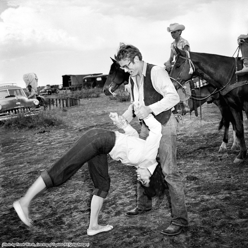 "Liz Taylor & James Dean horsing around during a break in filming ""Giant"", 1950s"