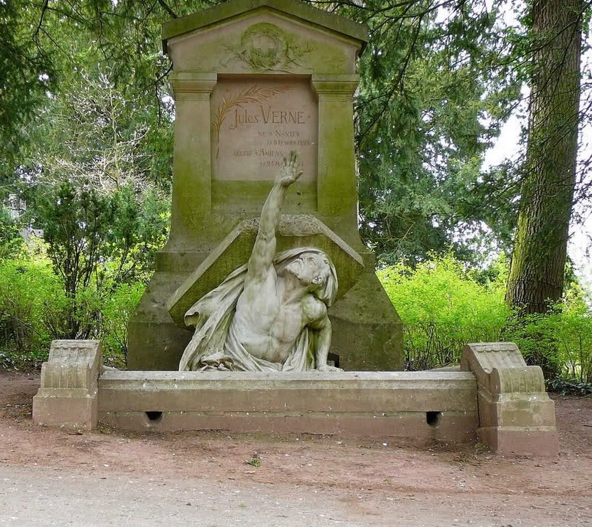 Jules Verne's gravestone (with a statue of him popping out from underit!)