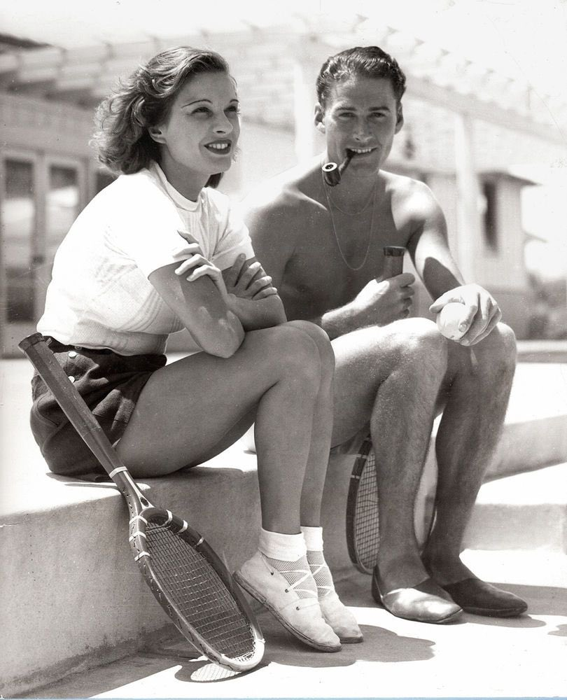 Lili Damita and Errol Flynn at the tennis court