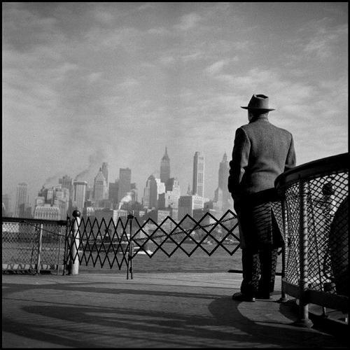 Man looking at the Manhattan skyline from the Staten Island Ferry, NYC, by Burt Glinn,1951