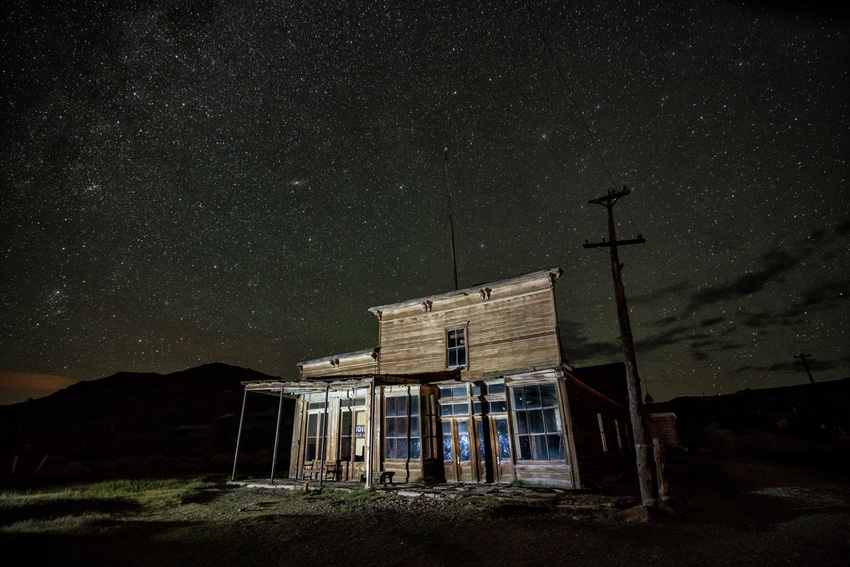 Abandoned building under a starry sky, California