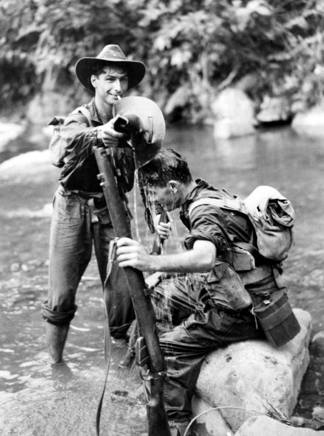 Two Australian soldiers cooling off during the Battle of the Pacific,WWII