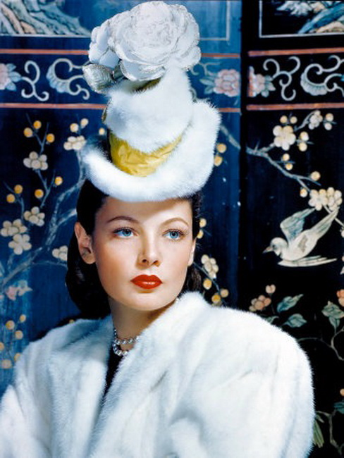 Gene Tierney wearing a fur hat with flowers on top (!)