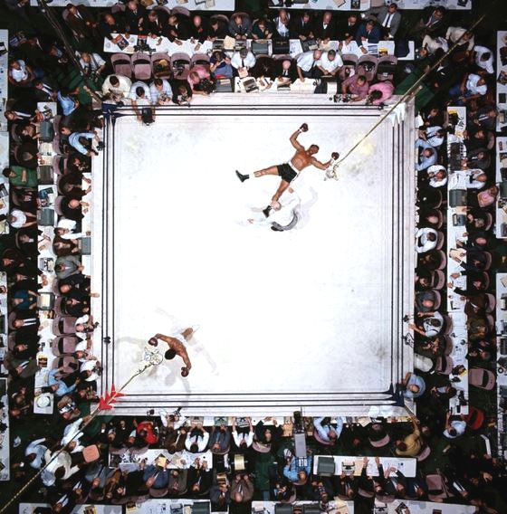 Muhammad Ali knocks-out Cleveland Williams at the Houston Astrodome, 1966 (Photo by Neil Leifer)