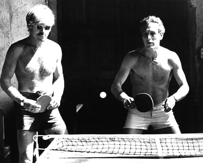 Shirtless Robert Redford and Paul Newman playing tabletennis