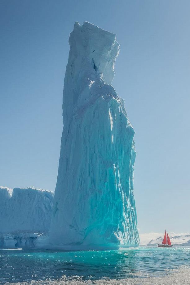 Iceberg and sailboat, photo by DanielKordan