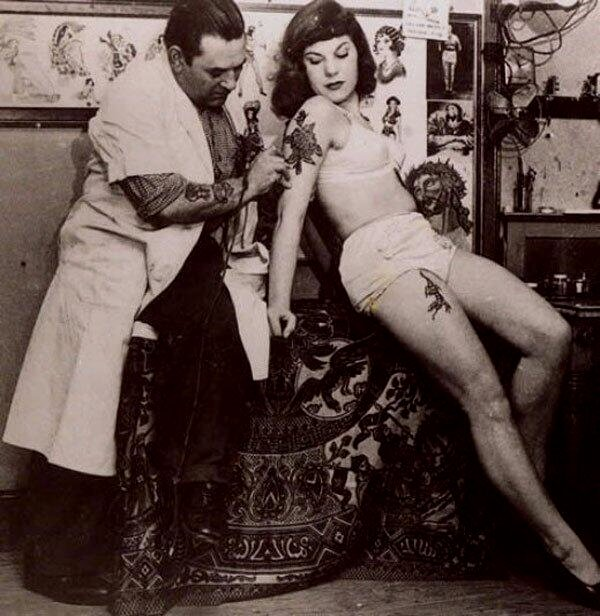 Vintage woman getting atattoo