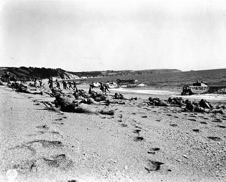 Allied troops practicing for the invasion of France (D-Day) on a beach in England, May 1944