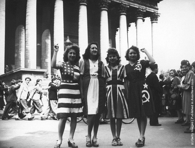 Women dressed in dresses of the flags of the allied victors at the end of WWII (V-E Day), Paris, 1945