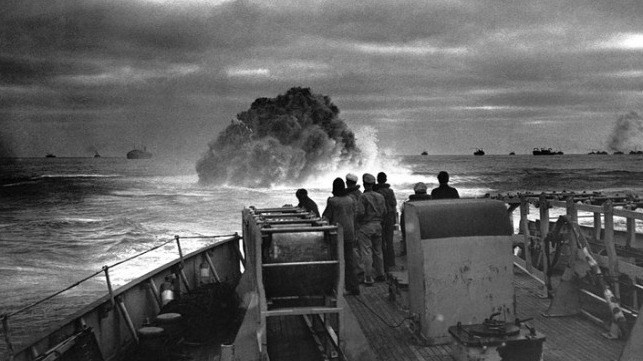 Dropping depth charges on a German submarine to protect an allied convoy, Battle of the Atlantic,WWII