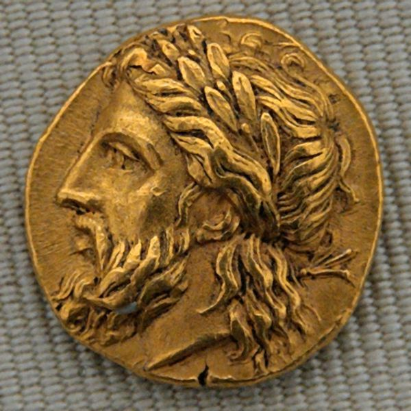 Beards of the ancients, gold Greek coin