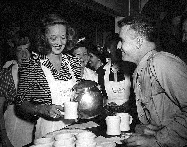 Bette Davis serving coffee at the Hollywood Canteen duringWWII