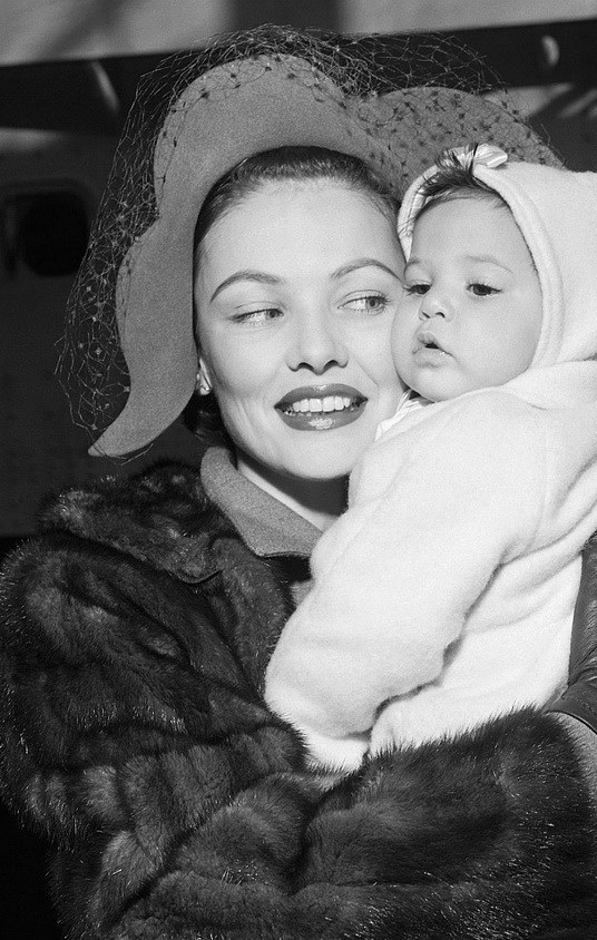 Gene Tierney and daughter, on board a ship crossing theAtlantic