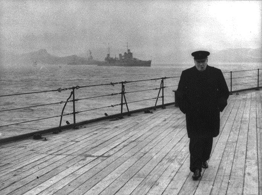 British Prime Minister Winston Churchill on board a Royal Navy vessel heading to a secret meeting int he North Atlantic during WWII