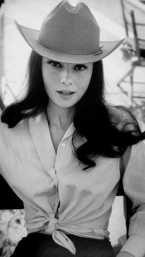Audrey Hepburn with long hair & wearing a cowboy hat