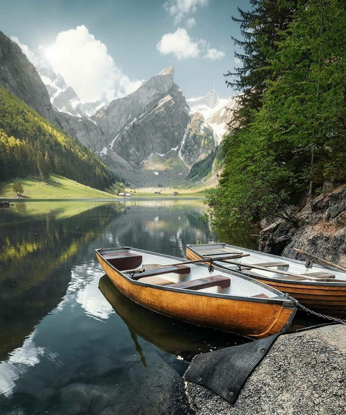 Boats on a lake in the mountains
