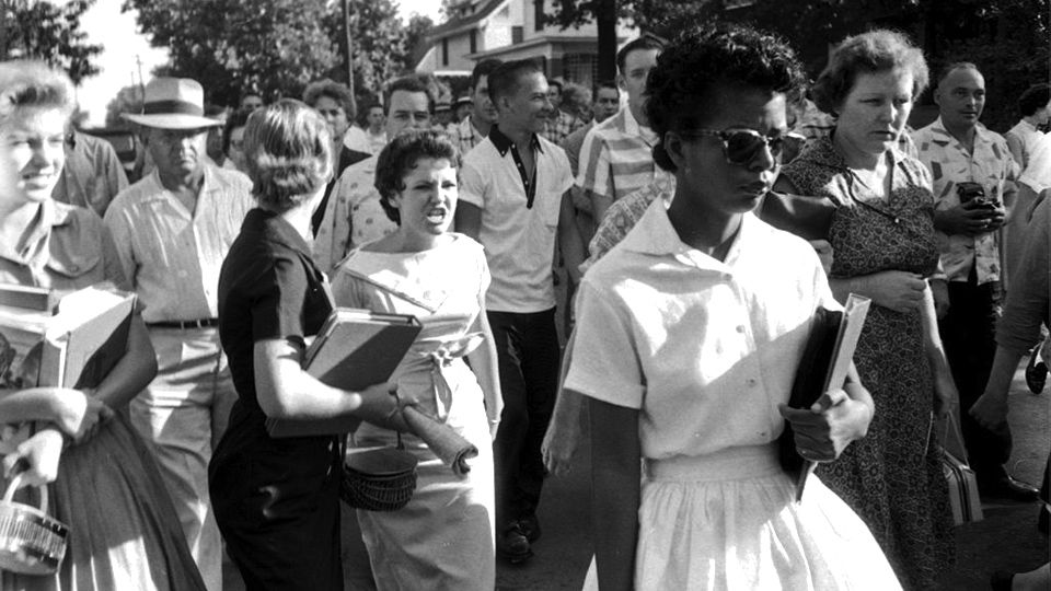 Black woman being harassed by white racists as public schools start to be integrated, 1950s