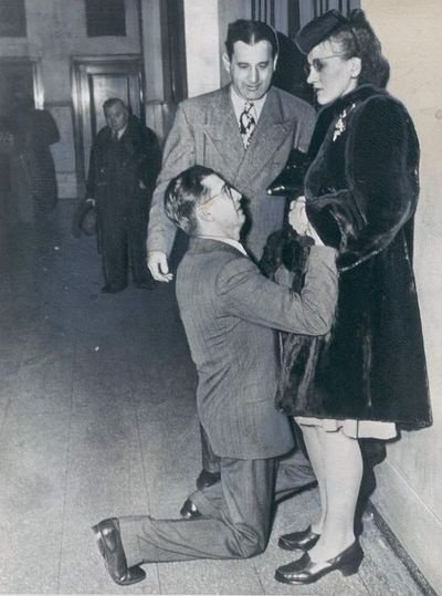 Man begging for forgiveness at the last minute outside a divorce court, Chicago, 1948