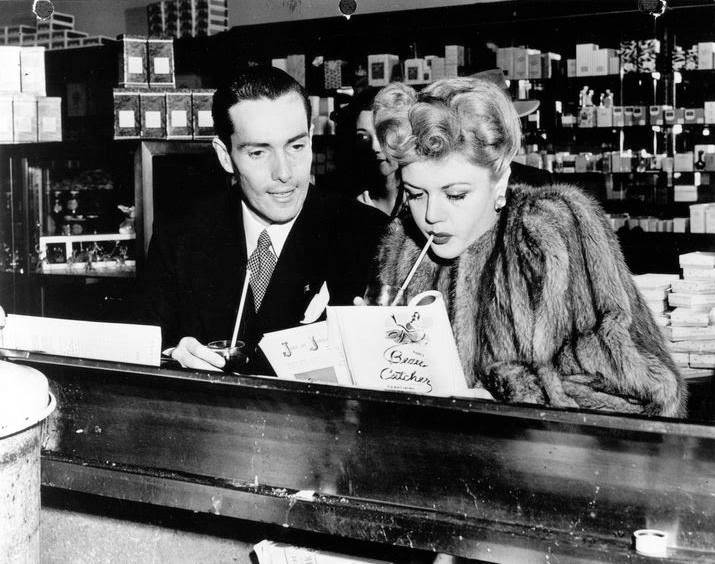 Hurd Hatfield and Angela Lansbury hanging out at the counter of Schwab's Pharmacy,1945