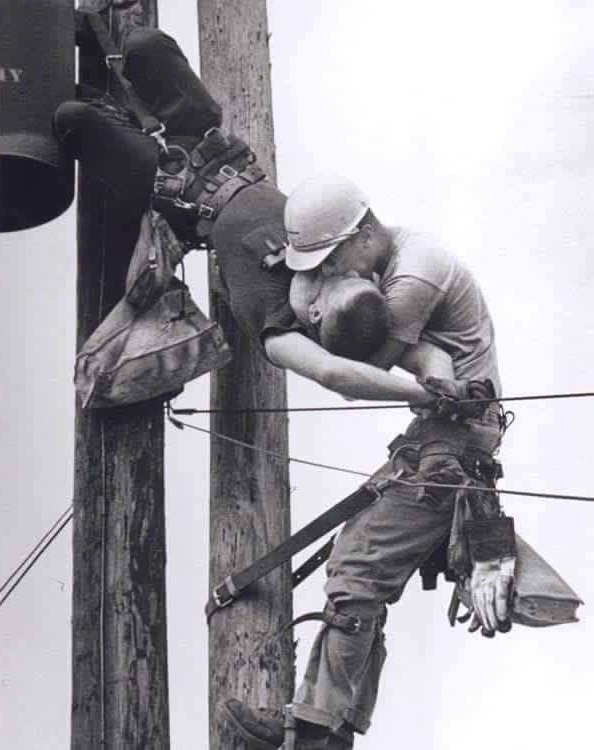 Power linesman getting mouth-to-mouth resuscitation after getting shocked by powerlines