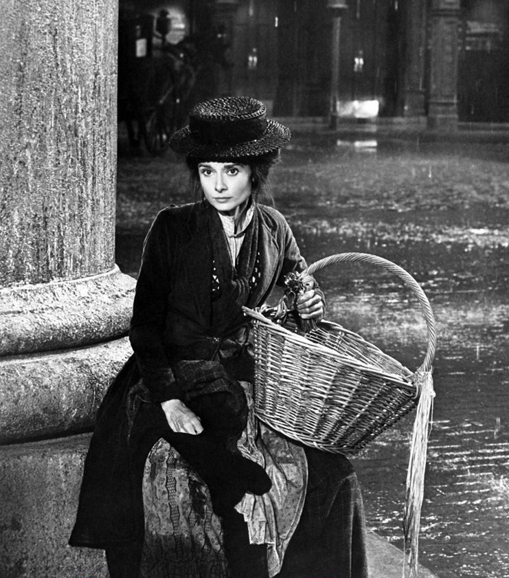 """Audrey Hepburn as a street seller in London during the 1800s in """"My FairLady"""""""