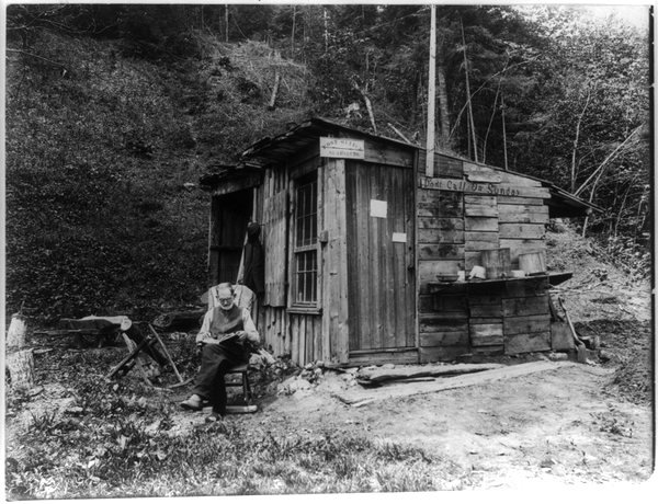 Man reading outside his hut, Vermont, I have no idea when(1920s?)