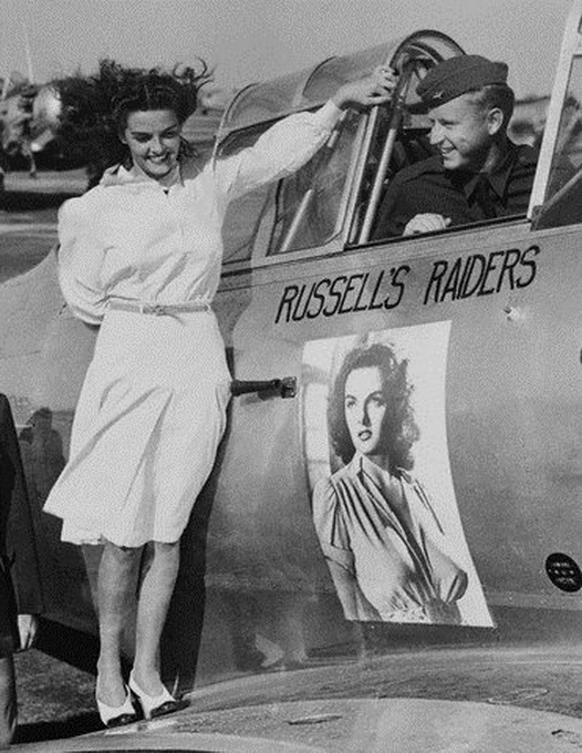 Jane Russell posing on the wing of a US Air Force plane named after her, WWII
