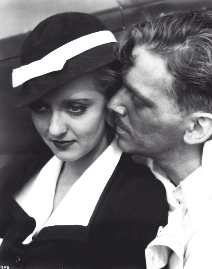 Bette Davis and the ruggedly handsome Douglas Fairbanks Jr.