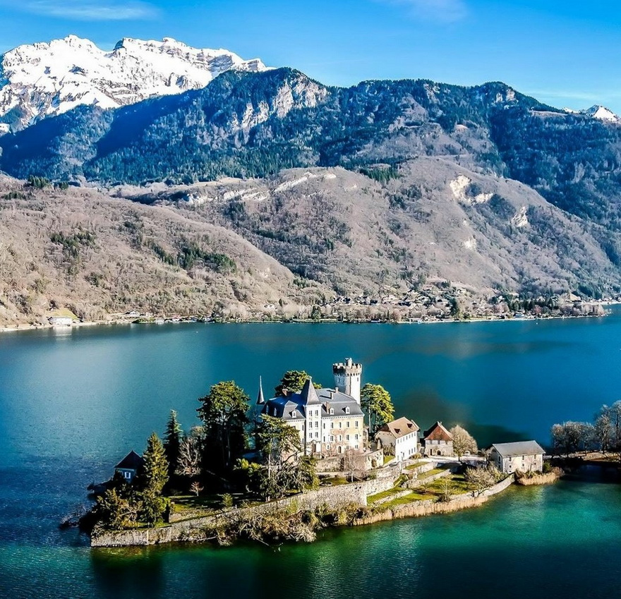 Castle on an island on a lake in the mountains