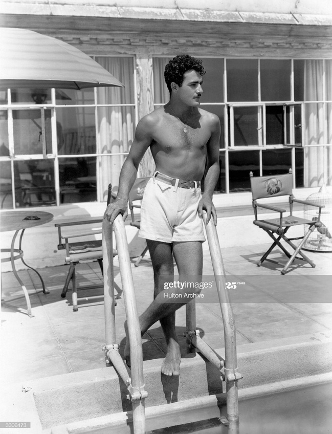 I'm swooning over this picture of actor Gilbert Roland in swim trunks, 1929