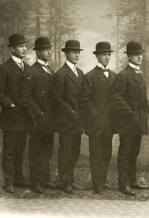 Five men wearing bowlerhats
